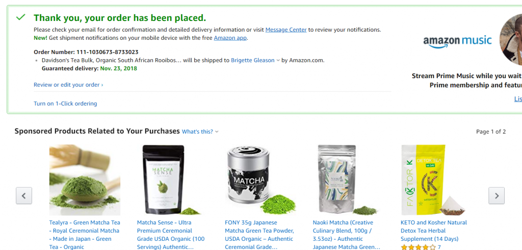 Amazon order confirmation page with sponsored products below.