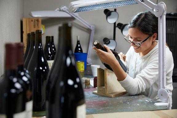 Hand painting wine bottles