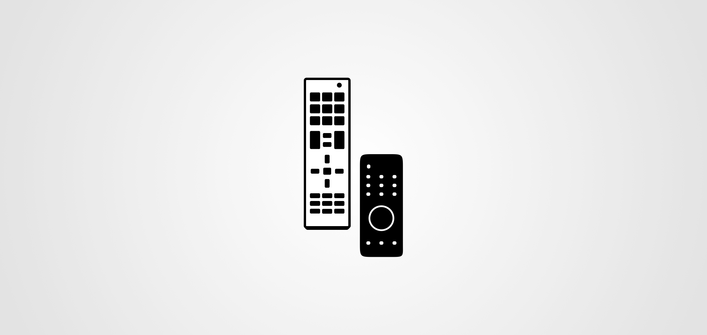 two TV remote controllers in black and white