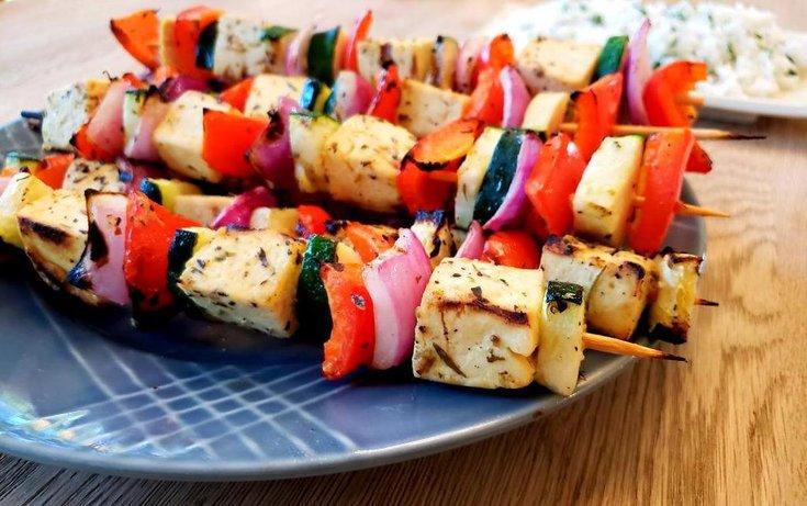 Plate of Mediterranean tofu and vegetable skewers