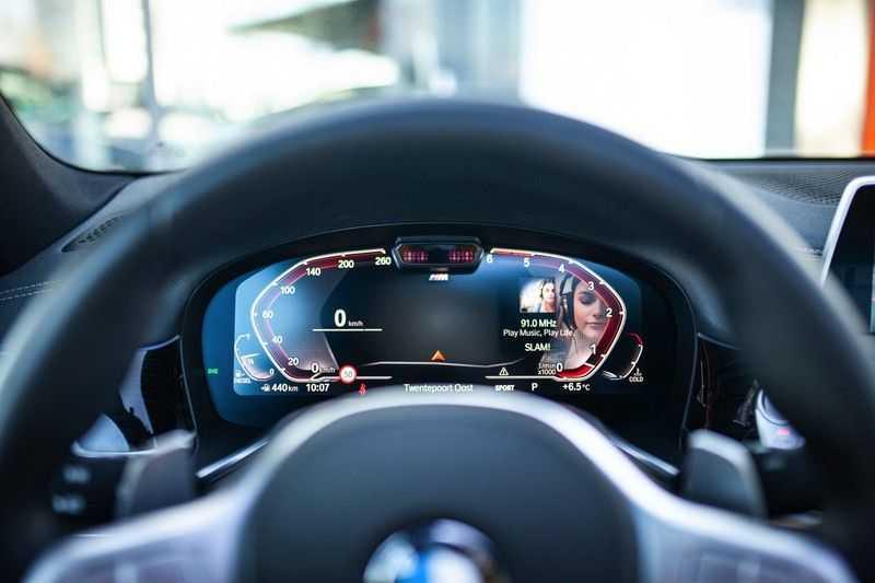 BMW 7 Serie 740d xDrive *Schuifdak / H&K / Memory / LED / ACC / Stoelventilatie* afbeelding 6
