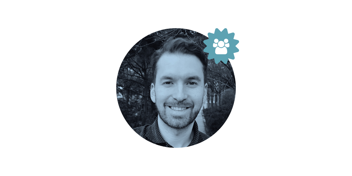 A UX designer smiling