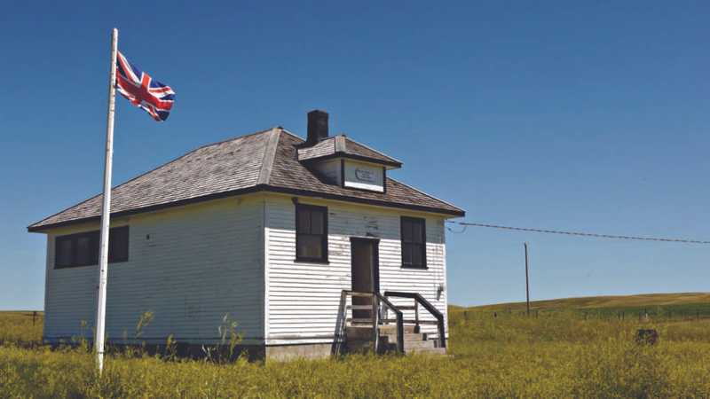 One room school house with a british flag beside