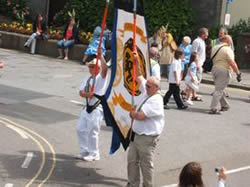 banner holders in the parade
