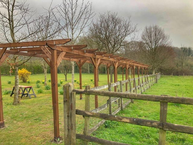 An example of 20 meter pergola, and surrounded by a view in the country side.