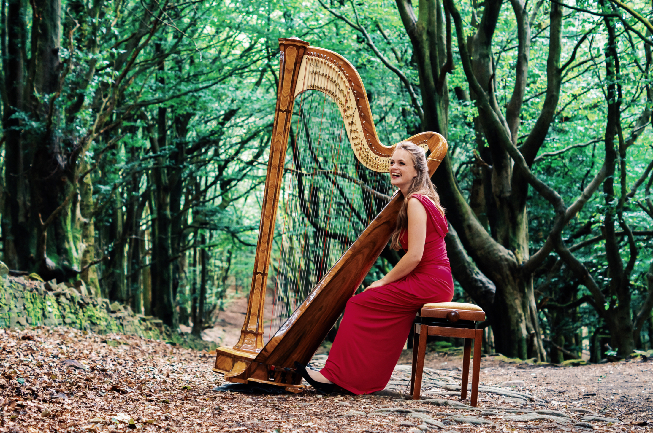 Natural, dreamy photography by Jack Watkins in woodland for award-winning classical musician and harpist, Lucy Nolan