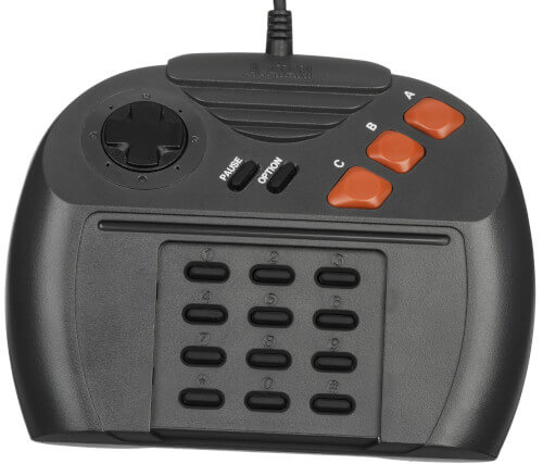 A photo of a controller the Atari Jaguar. This controller is an ergonomic nightmare, with a full 0-9 number pad underneath the main buttons