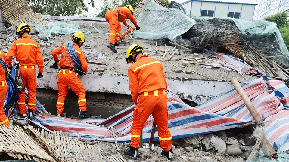 Emergency response leaders showcasing disaster resilience as they clear up a disaster site.