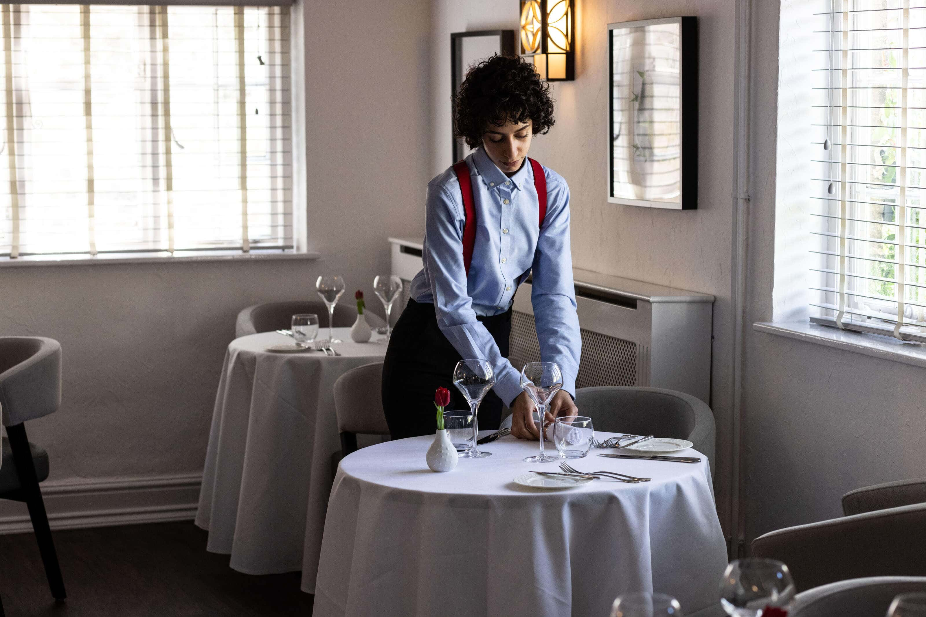 waitress laying a table