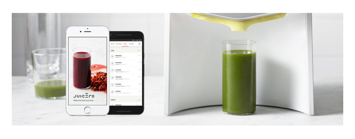 Juicero phone application displayed on an iPhone next to a glass of juice