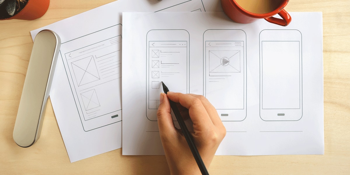 A UX designer sketching up wireframes