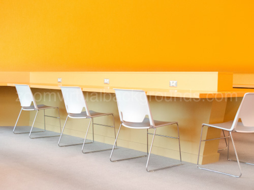 Bright Workspace Virtual Background for Zoom with orange painted walls and wooden desk