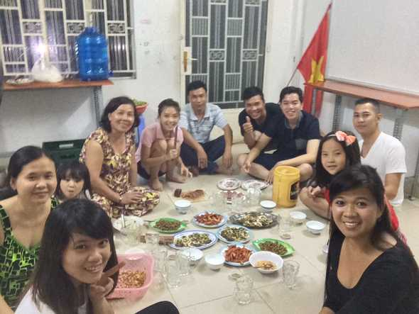 Vietnamese family eating dinner with men separate from the women