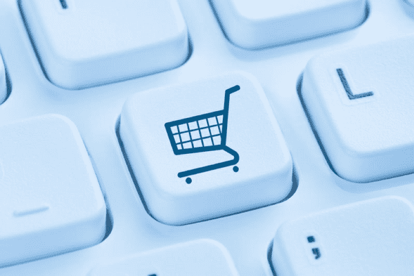 Photo of a keyboard, and the key that is in focus has a shopping cart on it.
