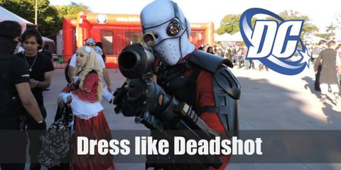 Deadshot has a white full-head mask on to hide his identity. He also wears a red long-sleeved spandex shirt with black armor on top, black pants, and boots.