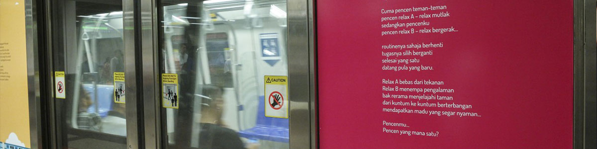 A photo of an MRT door, with a Poetry on Platforms peotry sticker on it.