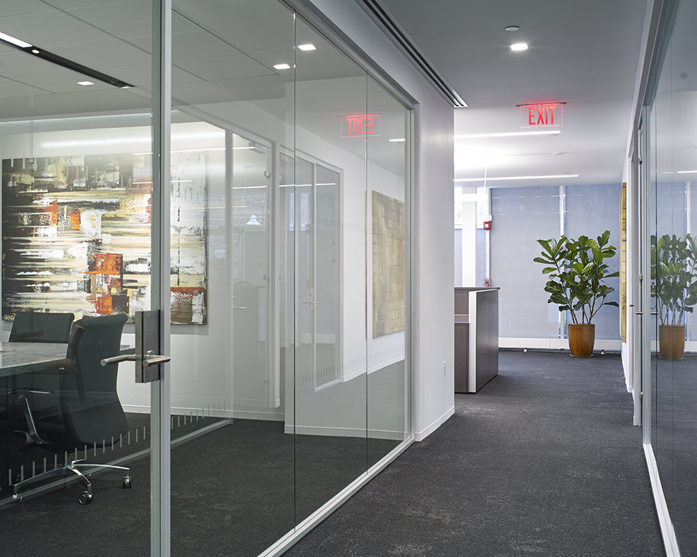 Office Hallway With Glass Doors and Paneling