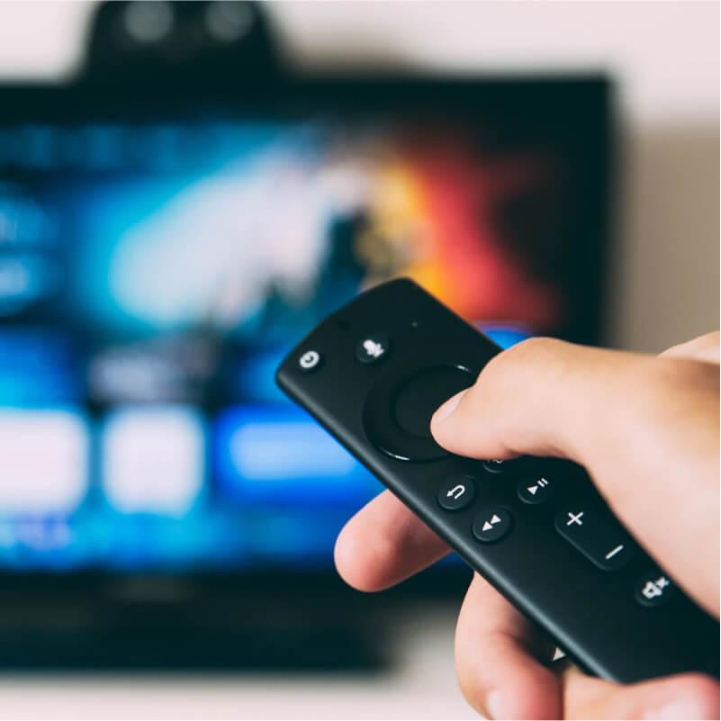 A viewer watching movies on OTT platform