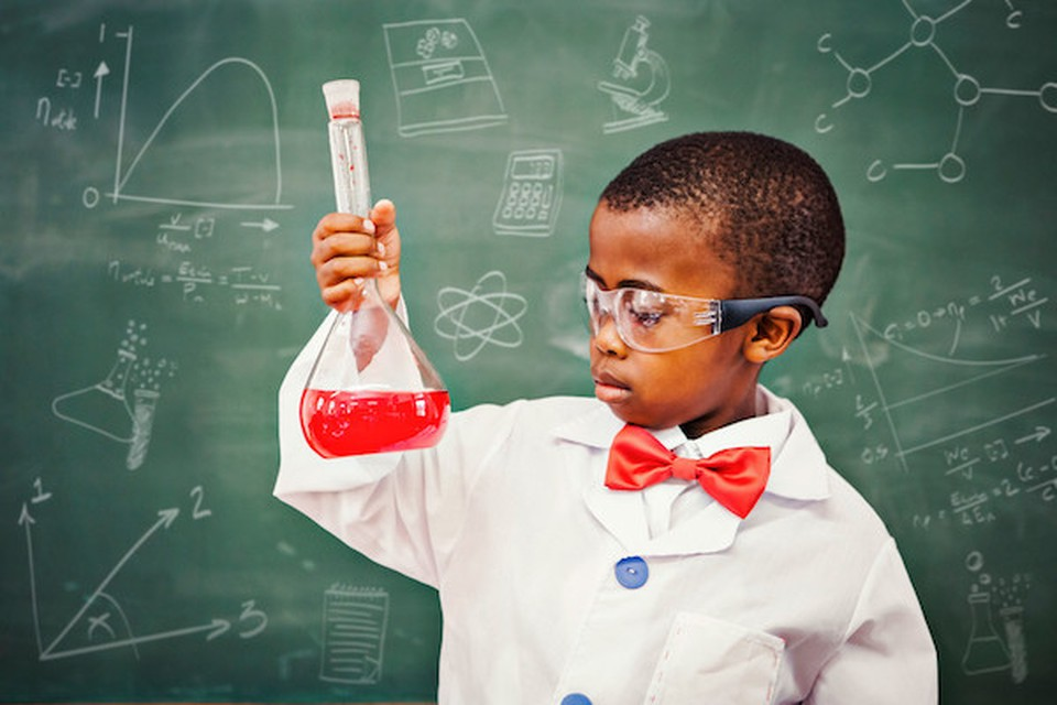 A boy dressed as a chemistry professor