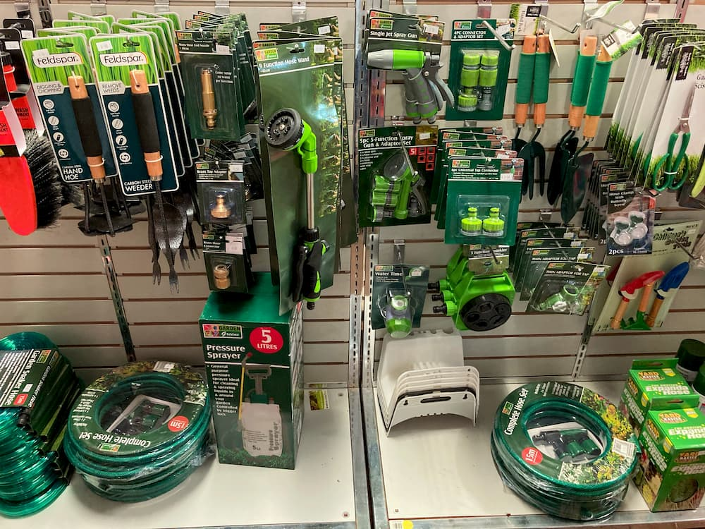 Hoses and hose fittings, garden tools, and other gardening products.