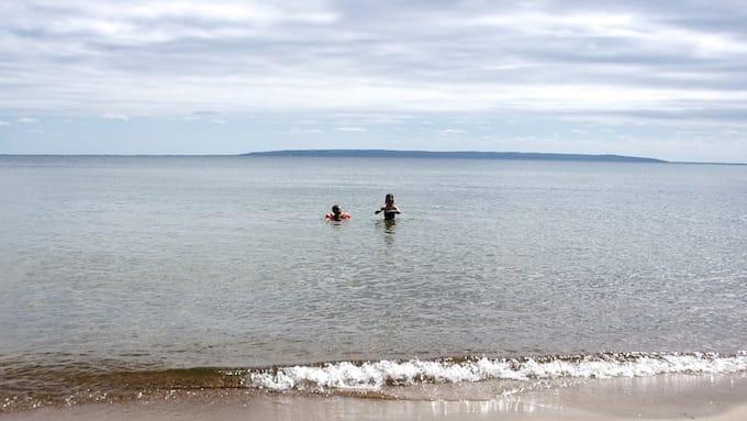 Children swimming in Lake Vättern, Sweden