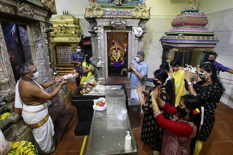 Hindus praying at a temple in Singapore