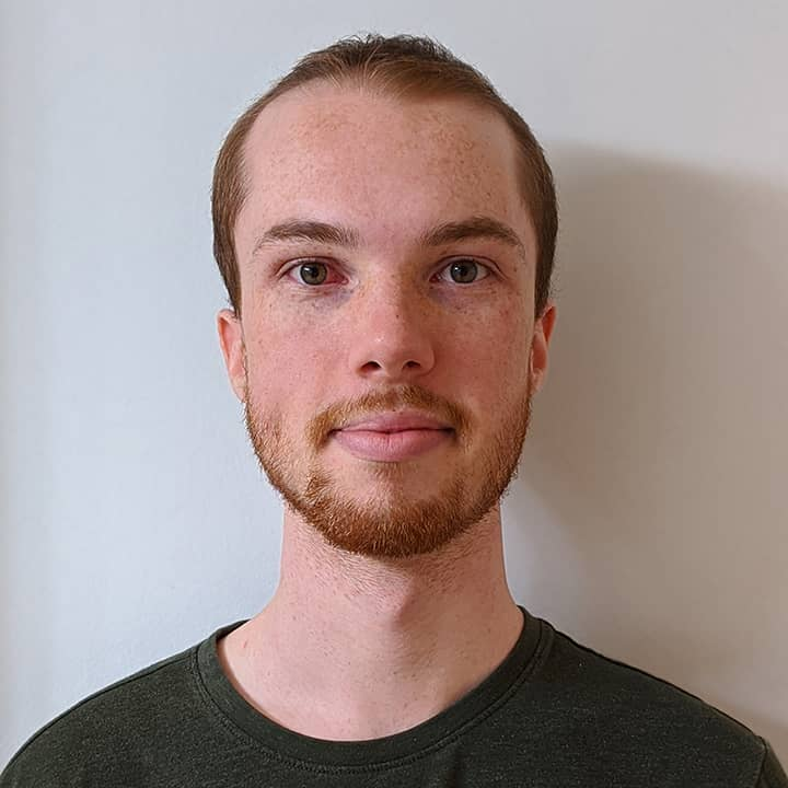 headshot photograph of Nolan Scobie against a blank wall