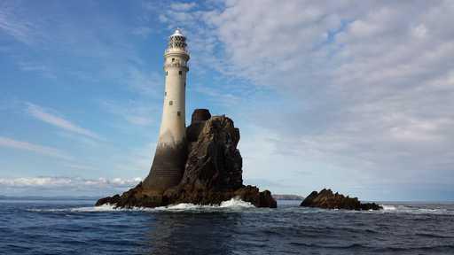 Lighthouse on rock in the sea in Belfas, Ireland, UK, Europe