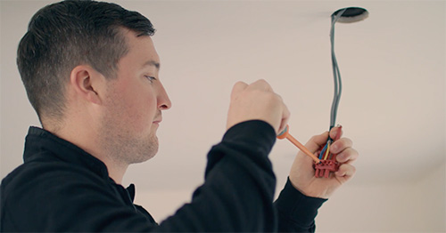 Picture of an electrician wiring a ceiling light