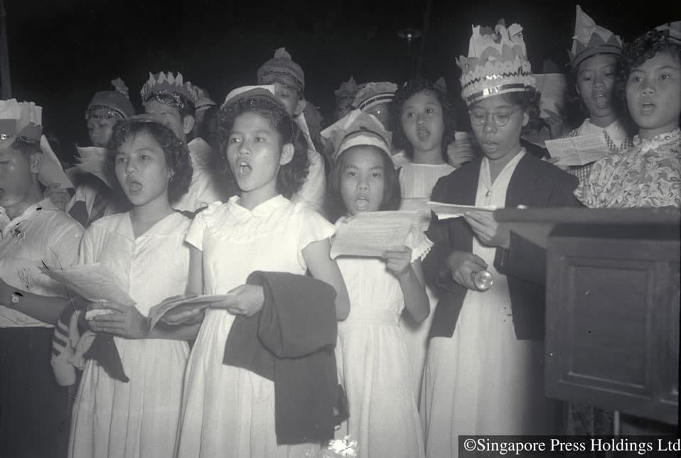 Christmas carollers singing at church, 1951
