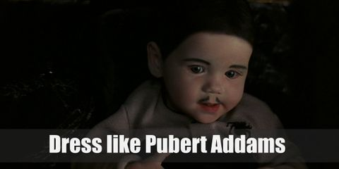 Pubert looks a lot like Gomez and even has a mini-moustache to show it. Pubert is mostly shown to have facial features like Gomez but the deathly pallor of Morticia. He also wears a long-sleeved gray onesie with a spider design on it.