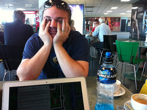 Thomas tired at cafe working