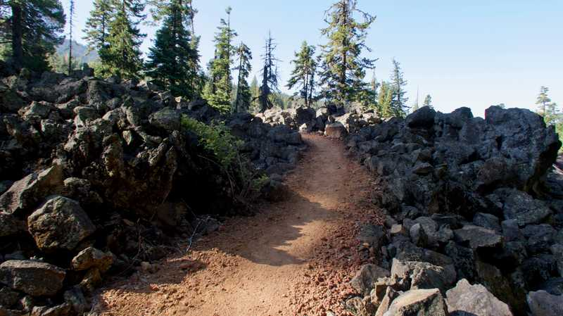 The PCT passing over lava rocks