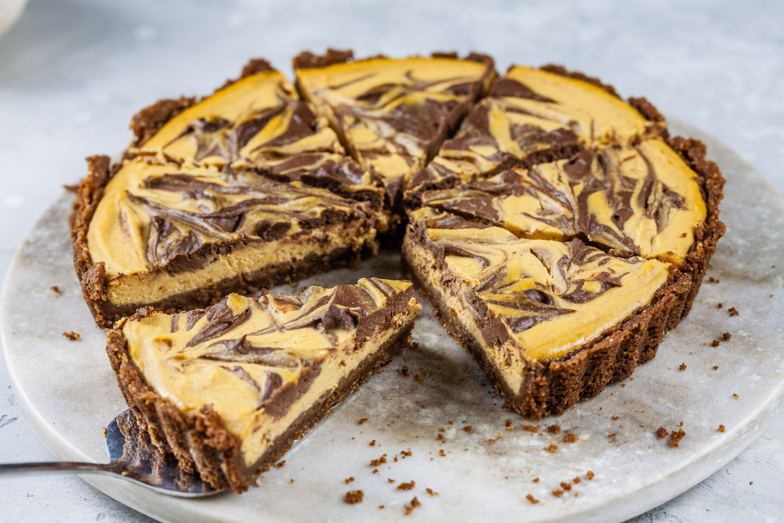 Marbled Chocolate Cheesecake Pumpkin Tart With A Biscoff Pecan Crust