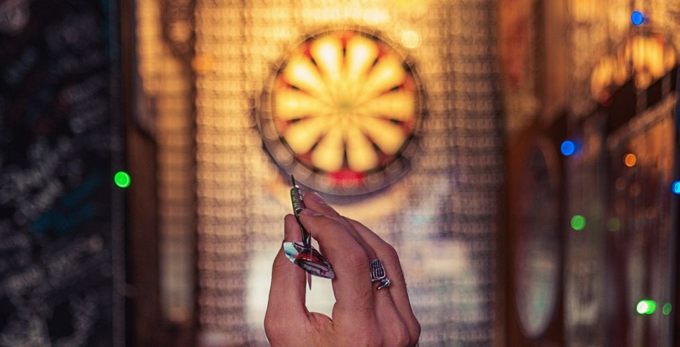 about to get a bullseye on a dart board
