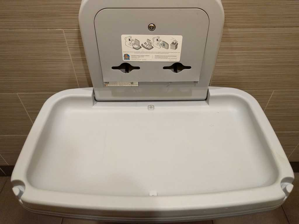 a changing table in a public restroom