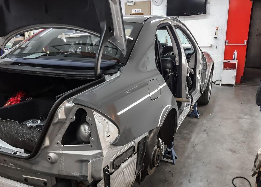 Mercedes E55 AMG being vinyl wrapped in nardo grey
