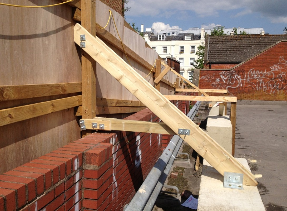 timber construction hoarding with supports