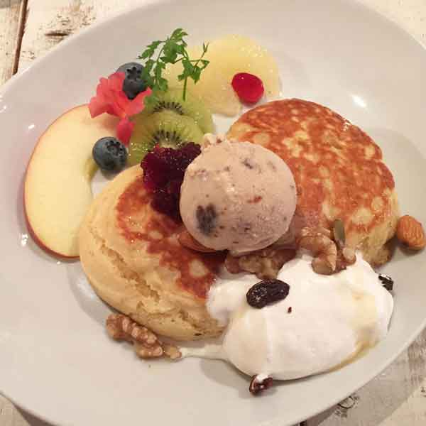 vegan pancakes with whipped cream and ice cream