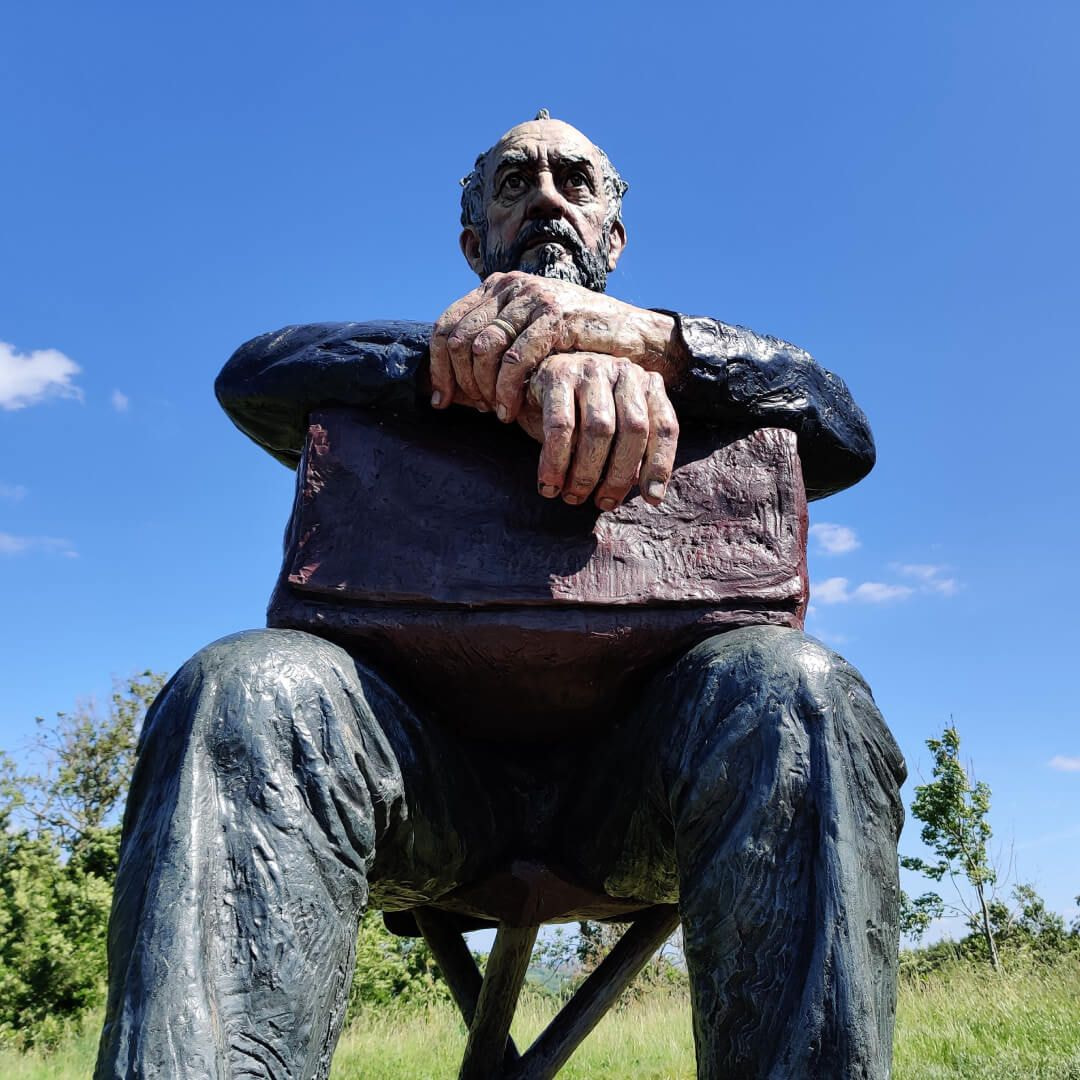 Seated Figure in sun Yorkshire Sculpture Park