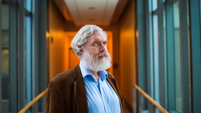 Image of George Church looking longingly into the distance.