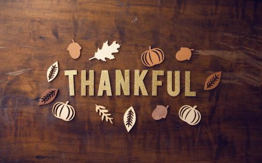 spelled out thankful on wood