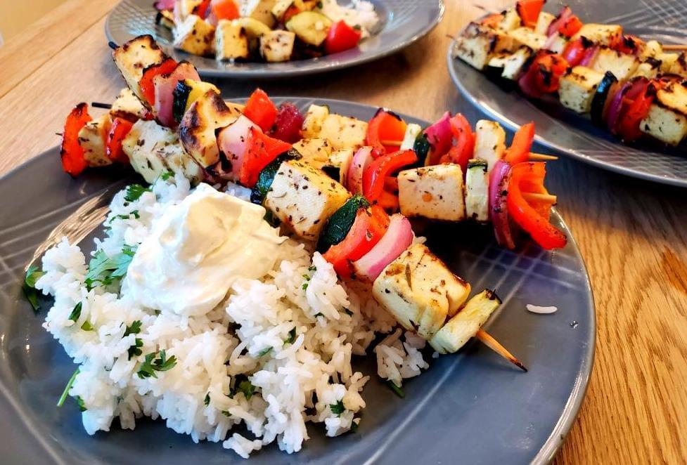 Plate with tofu, vegetable skewers and rice