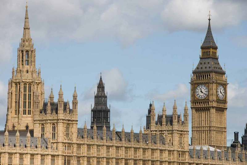 Big Ben clock tower and the central tower rise above Westminster Palace in London
