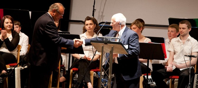 Ross Mainland making the presentation to Sandy Cluness, photo by Billy Fox Photography