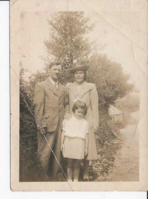 Marie aged about 4 with her parents outside 'Silver Down Farm' in Shute Lane, Pensilva
