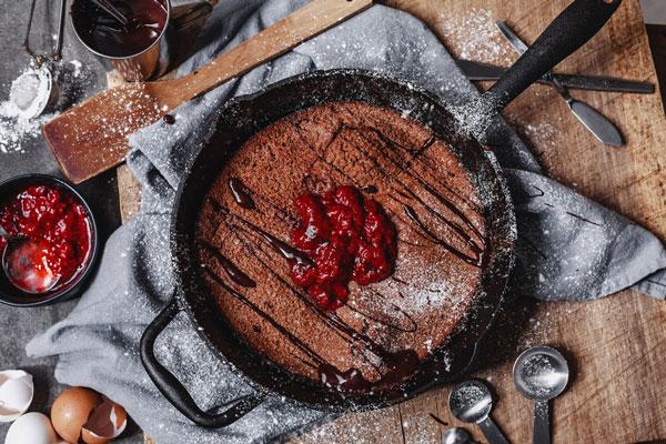 Chocolate Dutch Baby With Homemade Strawberry And Chocolate Sauce
