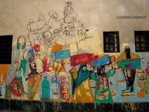 [In between the pharaonic murals and the martyrs' murals, Hanaa al-Degham created this beautiful, still unfinished mural. The theme of gas cylinders is highly relevant given the constant reoccurrence of gas shortages in Egypt.]