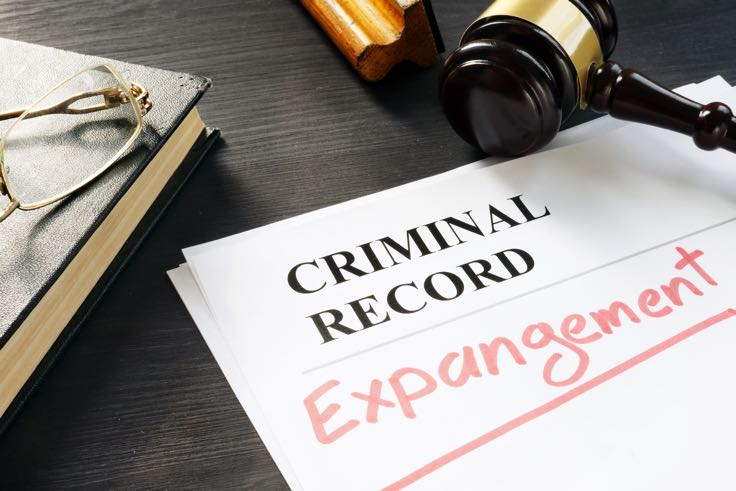 Paperwork for criminal record expungement on desk