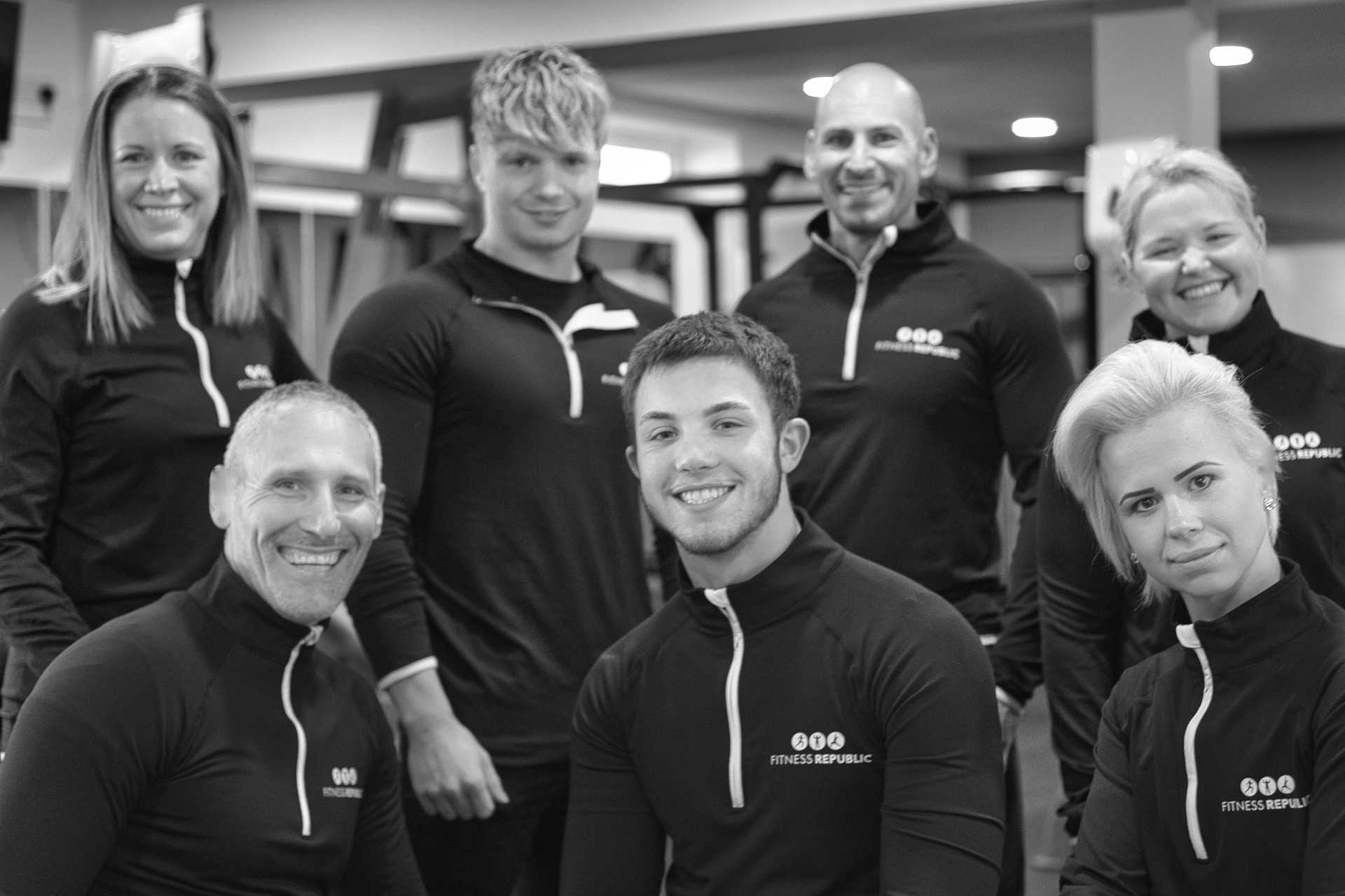 Black and white group shot of our fitness team in our gym in ashby